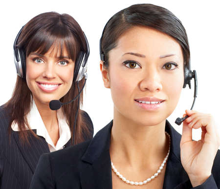 Beautiful  call center operators with headset. Over white background   photo