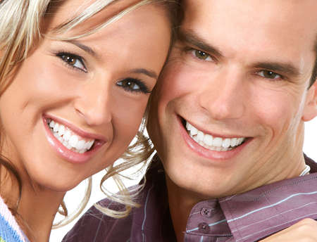 teeth whitening: Happy smiling couple in love. Over white background