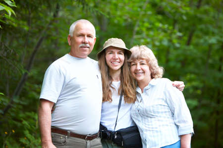 Smiling happy family in the summer park  Stock Photo