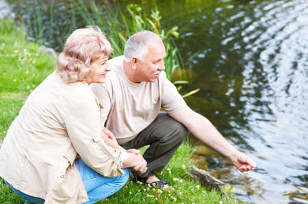 Smiling happy  elderly couple in the summer park Stock Photo - 5349692