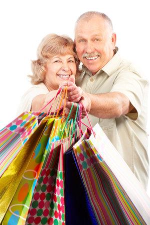 Happy shopping elderly people. Isolated over white backfround  photo