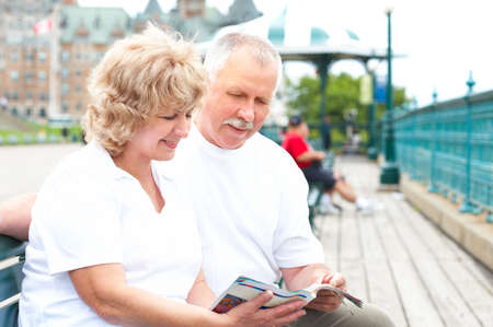 Smiling happy elderly couple in the city