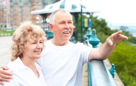 Smiling happy elderly couple in the city  photo