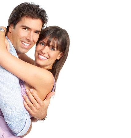 parejas felices: Feliz sonriente joven en el amor. M�s de fondo blanco Foto de archivo