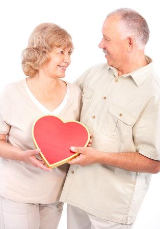 Happy elderly couple in love. Isolated over white backfround  photo