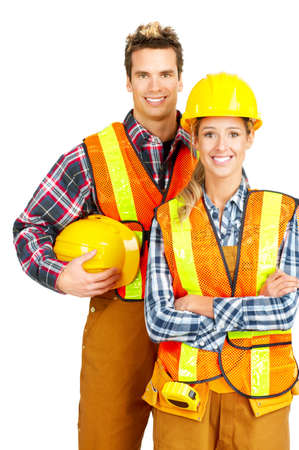 Young builder people  in yellow uniform. Isolated over white background Stock Photo - 5364947