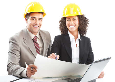 Working young architects. Isolated over white background Stock Photo - 5403828