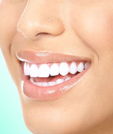 Beautiful young woman teeth. Isolated over  white background Stock Photo - 5403767