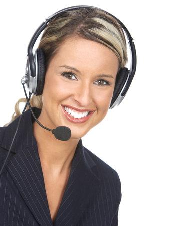 telephone headsets: Hermosa mujer de negocios con el auricular. Sobre fondo blanco Foto de archivo