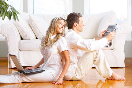 Young love couple smiling in the comfortable apartment  photo