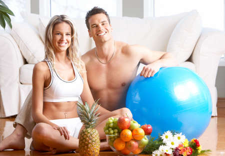 settler: Young love couple with fruits in the comfortable apartment