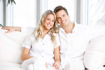 the apartment: Young love couple smiling in the comfortable apartment  Stock Photo
