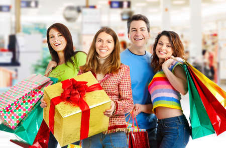malls: Happy shopping people in the mall  Stock Photo