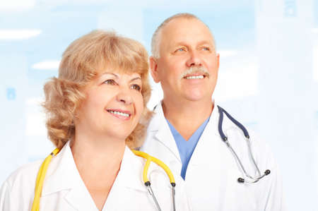 Smiling medical doctors with stethoscope. Over blue background
