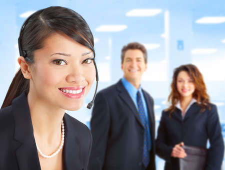 Beautiful  business woman with headset in the office