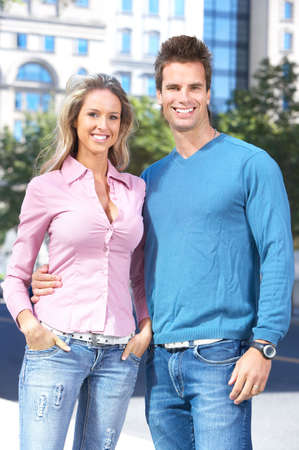 Happy smiling couple in love walking on the street