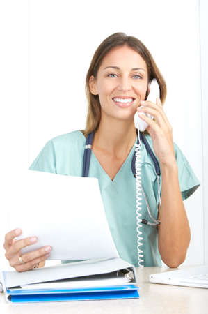 Smiling medical nurse with telephone and laptop Stock Photo - 5533020