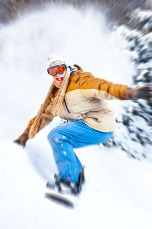 ski track: Young  happy smiling man with snowboard. Winter sport  Stock Photo