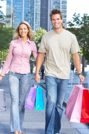 Shopping  smile couple on the street  photo