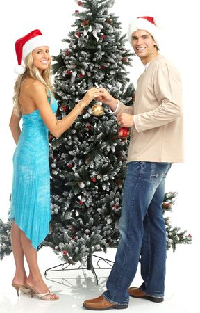 Young happy couple near  a Christmas tree. Isolated over white background Stock Photo - 5662609