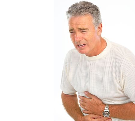 heartburn: man having stomach pain. Isolated over white background