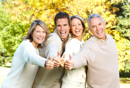 Happy family in park. Father, mother, son and daughter Stock Photo - 5713451
