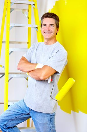 smiling handsome man near the painted  interior wall of home. Stock Photo - 5713770