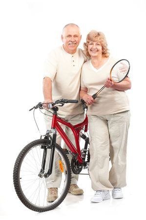 Active elderly couple. Isolated over white background photo