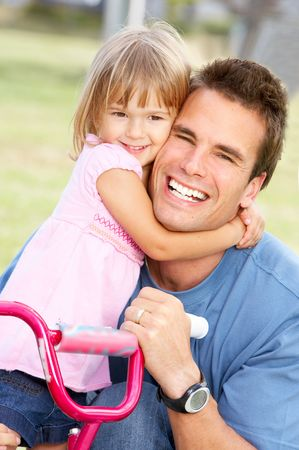 Happy family. Father  and daughter in the park Stock Photo - 5720356