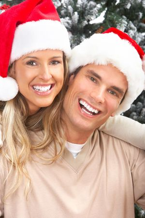 Young happy couple near  a Christmas tree. Isolated over white background Stock Photo - 5753548