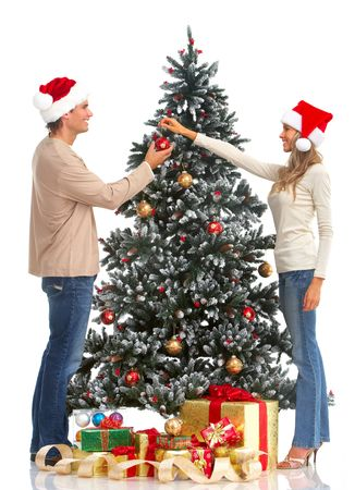 Young happy couple near  a Christmas tree. Isolated over white background Stock Photo - 5753566