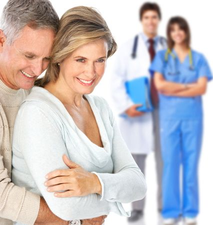 happy patient: Smiling medical doctor with stethoscope and elderly couple Stock Photo