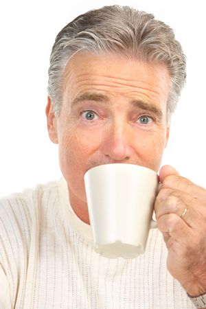 Mature smiling man drinking tea photo
