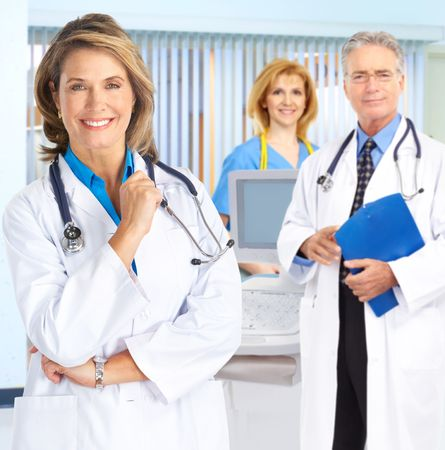 Smiling medical people with stethoscopes. Doctors and nurses   photo