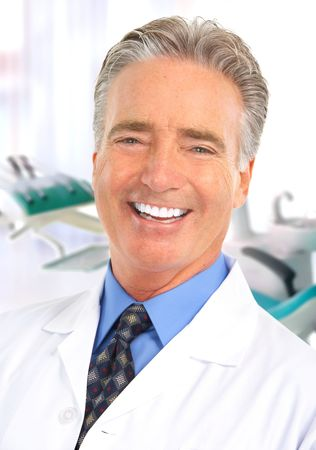 Smiling mature dentist doctor in the office  photo