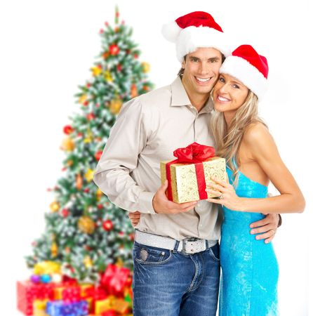 Young happy couple near  a Christmas tree. Isolated over white background Stock Photo - 5813218