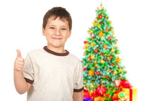 Funny smiling boy and christmas tree. Isolated over white background  photo