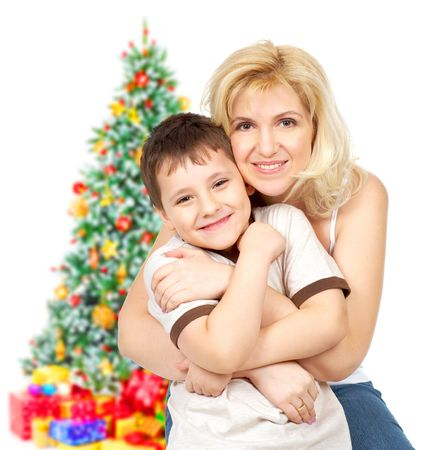 Mother and son near Christmas tree. Isolated over white background  photo