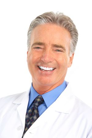 Smiling mature dentist doctor . Isolated over white background  photo