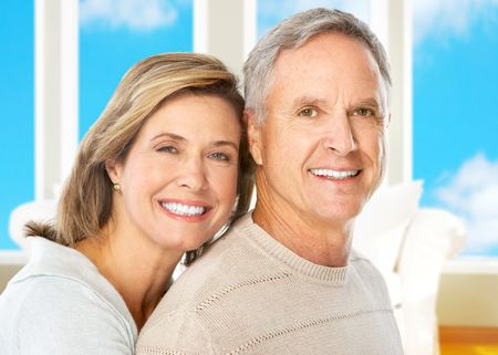 Happy smiling elderly couple at home Stock Photo