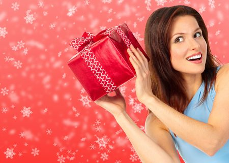 Christmas shopping smiling  woman . Over red  background