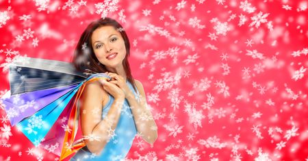 Christmas shopping smiling woman . Over snow background