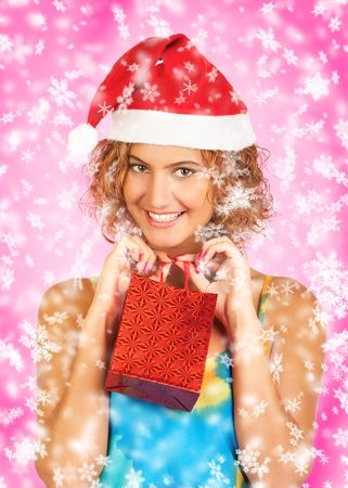Christmas woman in a Santa Cap with a gift photo