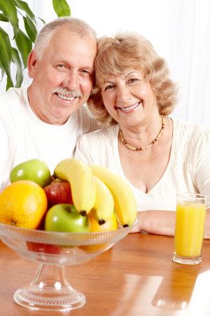 Senior couple with fresh fruits.   photo