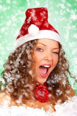 Christmas winking woman in a Santa Cap.  photo