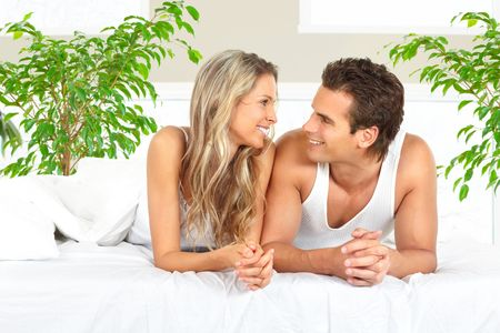 sleep: Young happy couple in a bed at home  Stock Photo