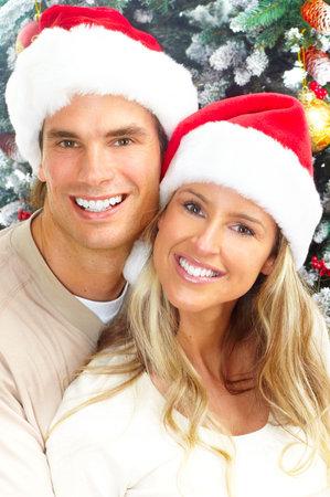 Young happy couple near  a Christmas tree. Stock Photo