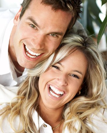 Young love couple smiling at home photo