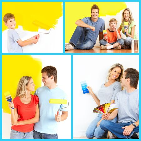 Renovation. Young family painting interior wall of home.    photo