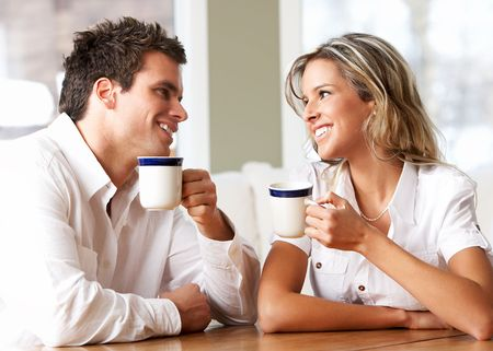 Young love couple taking breakfast  in the comfortable apartment  photo